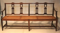 A rare Cape Neo-Classical Stinkwood Fiddle Back Riempies bench
